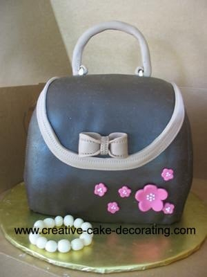 3d handbag cake in grey with pink flowers
