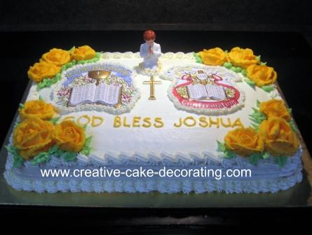 Rectangle white cake decorated with yellow roses and a human figurine.