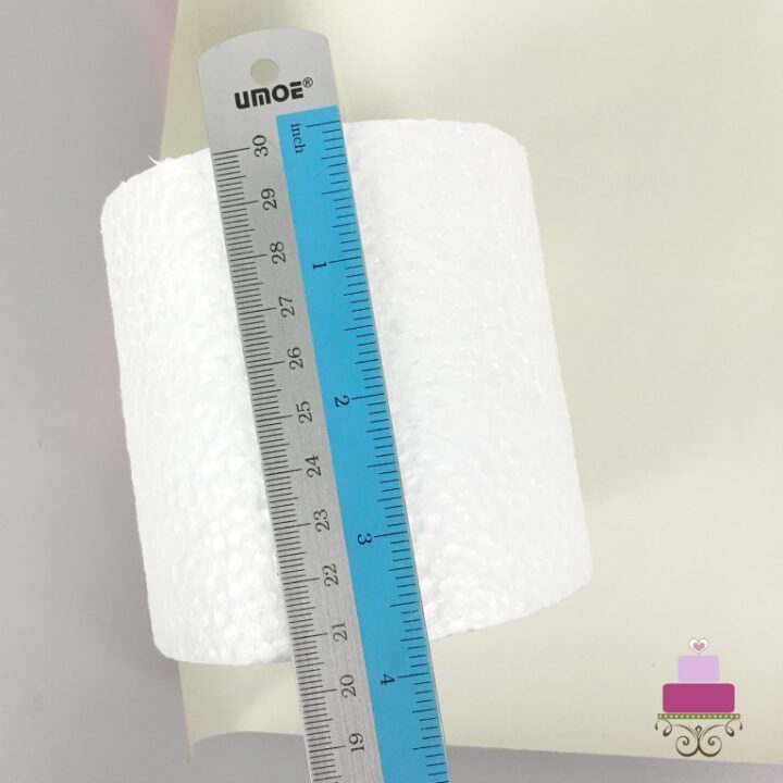 Using a ruler to measure the height of a styrofoam block