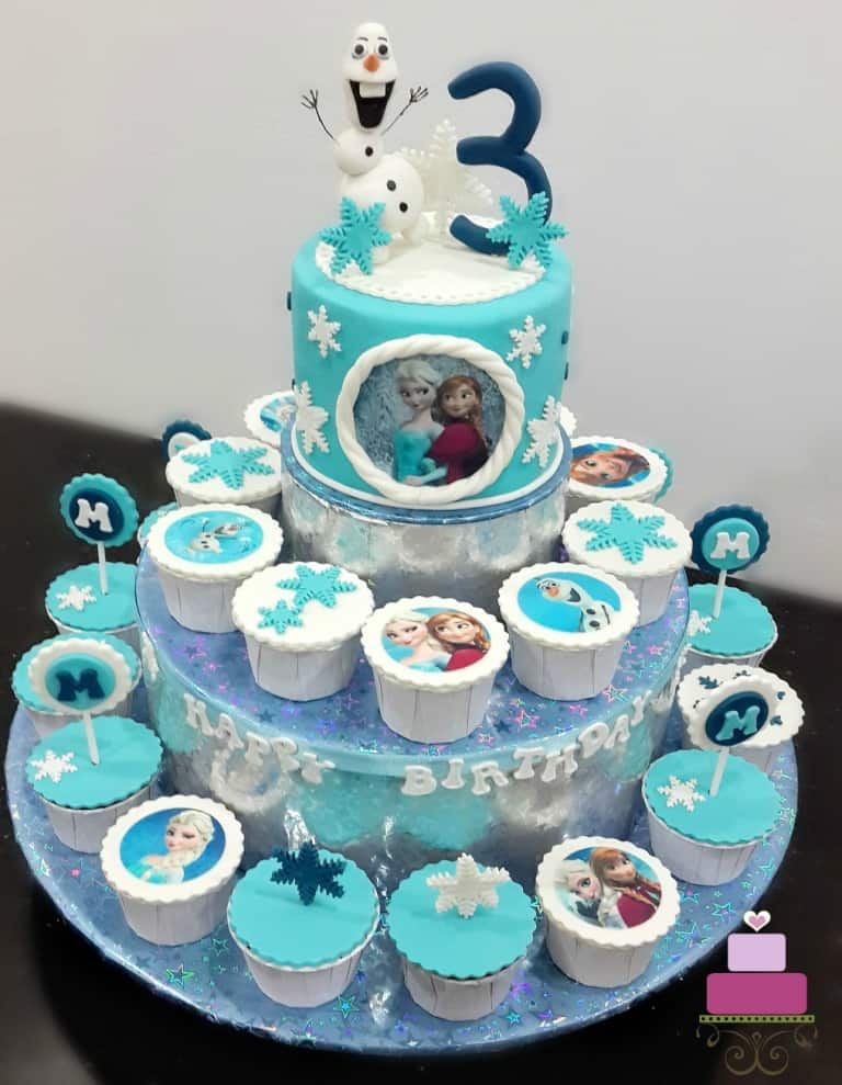 Frozen themed cake and cupcakes on a DIY cupcake holder