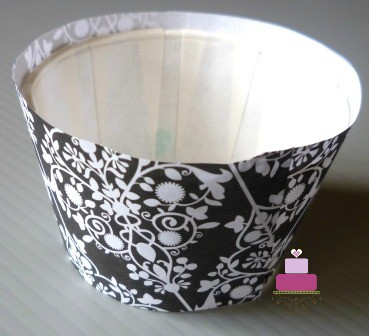 A cupcake casing in a damask wrapper