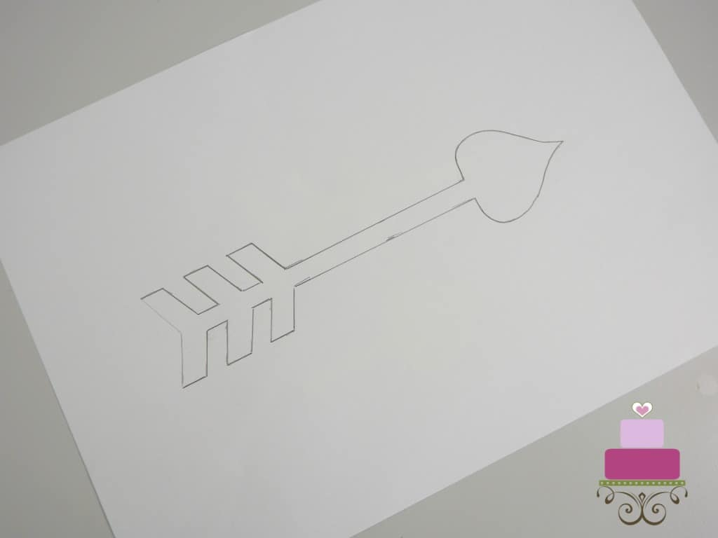 Arrow outline on a piece of white paper