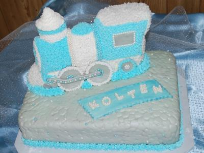 Rectangle cake with a blue train shaped cake on top.