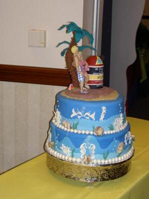 2 tier cake with blue fondant in beach theme decoration