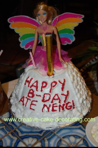 Doll birthday cake with wings