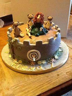 Round cake with figurines from Brave movie