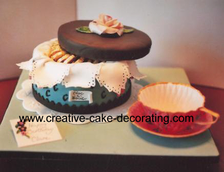 Cake in the shape of a chocolate box and lid.