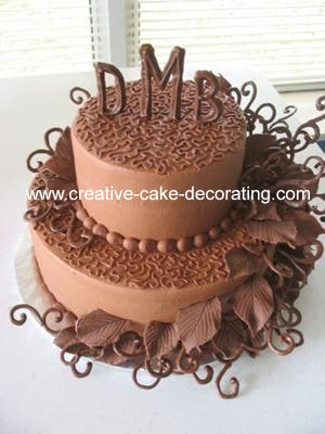 2 tier chocolate cake with scrolls chocolate icing