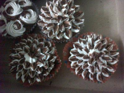 Cupcakes decorated with brown buttercream to look like chrysanthemums