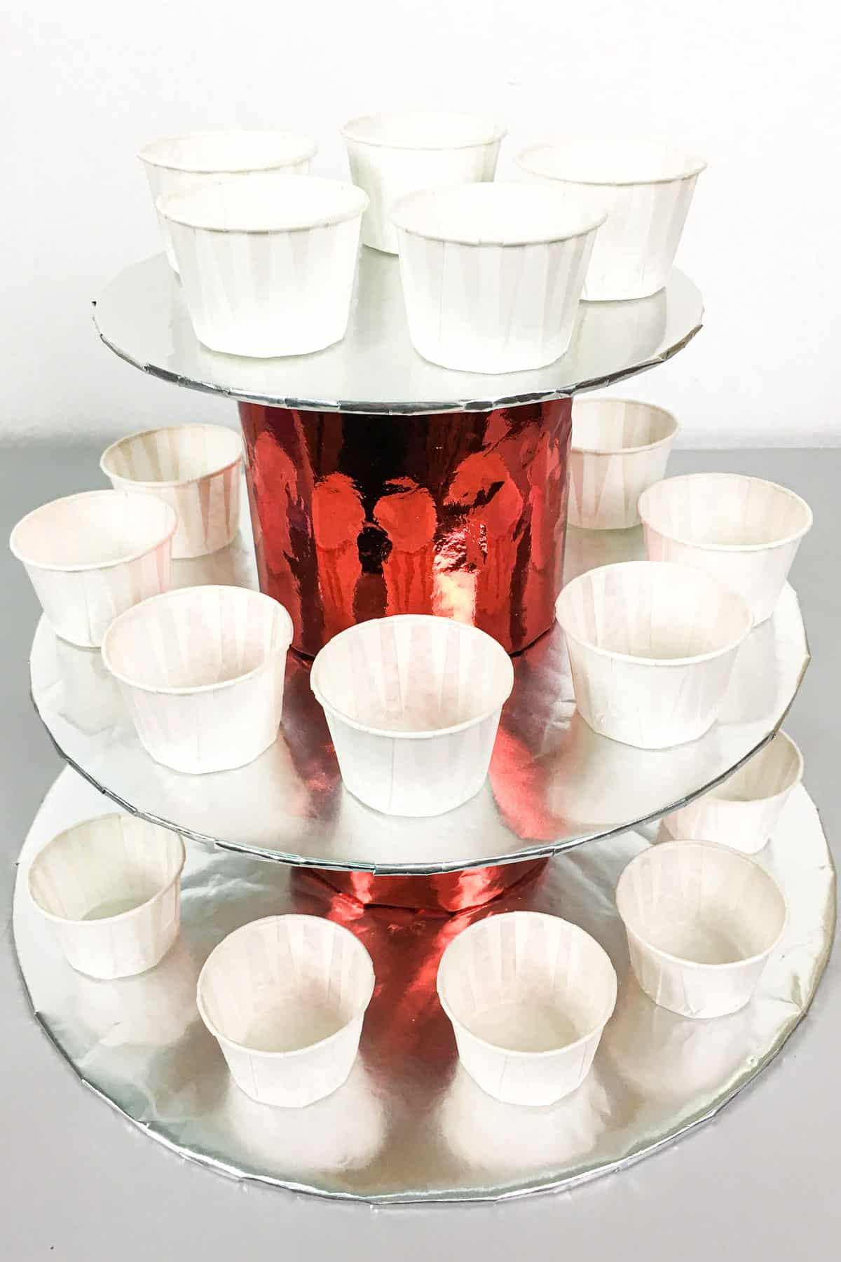 A 3 tier cupcake holder in silver and red