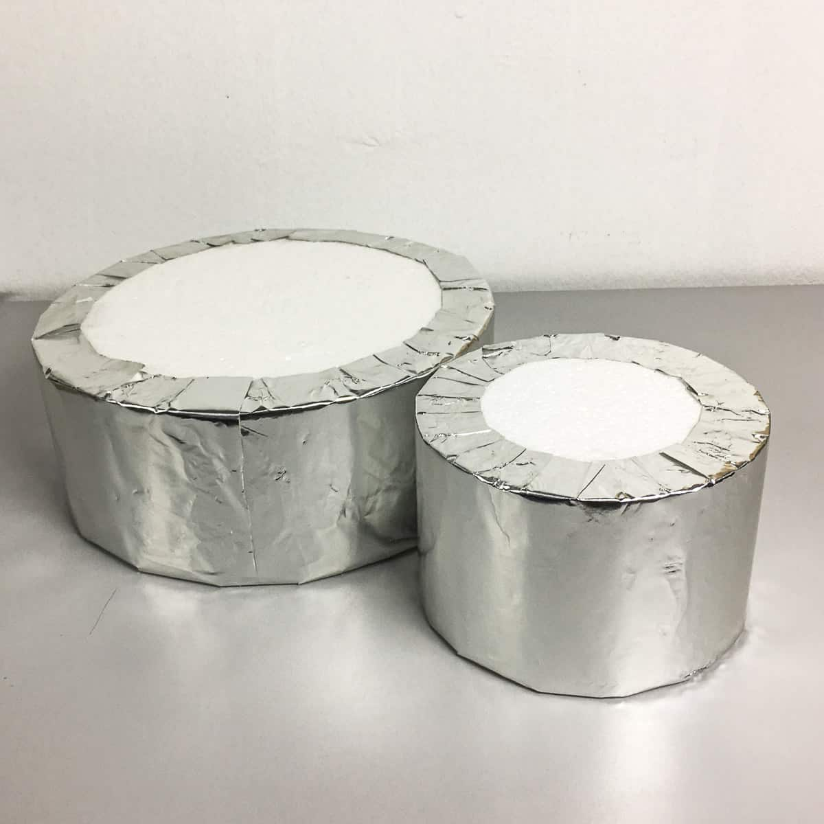 2 pieces of styrofoam blocks wrapped in silver paper.