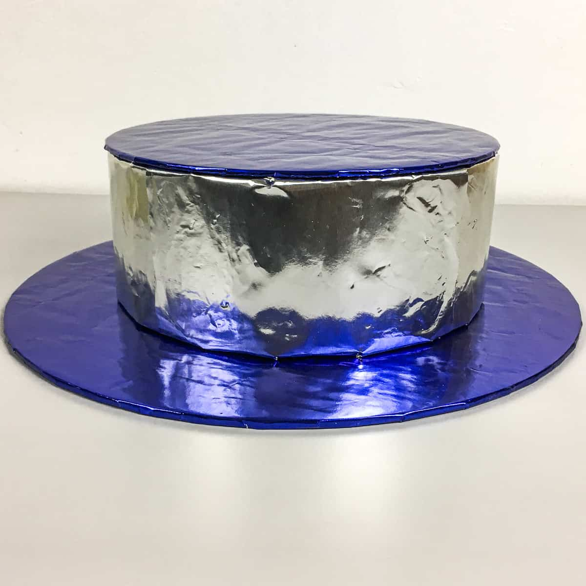 Bottom tier of a DIY cake stand in blue and silver