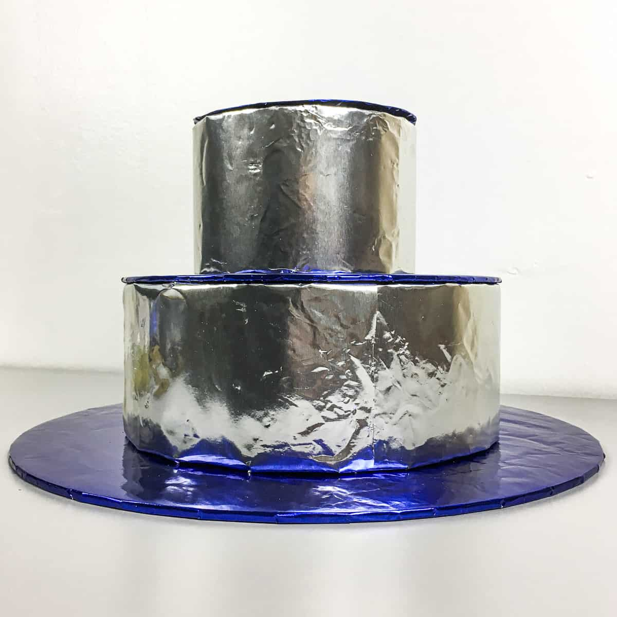 side view of a completed blue and silver cupcake stand