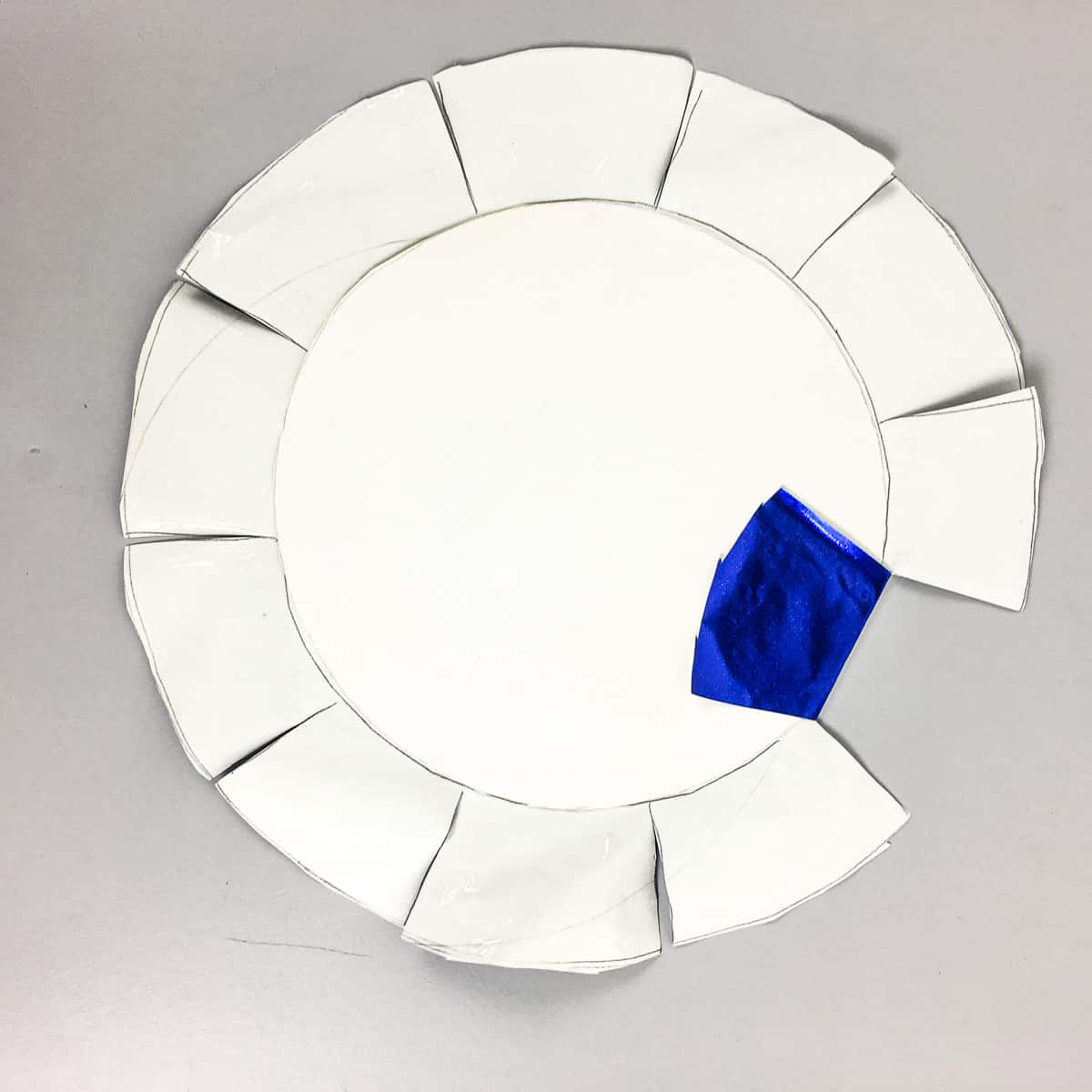 Wrapping a cake board with blue paper
