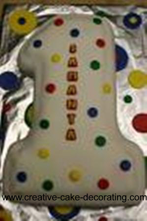 A number one shaped cake with colorful dots design