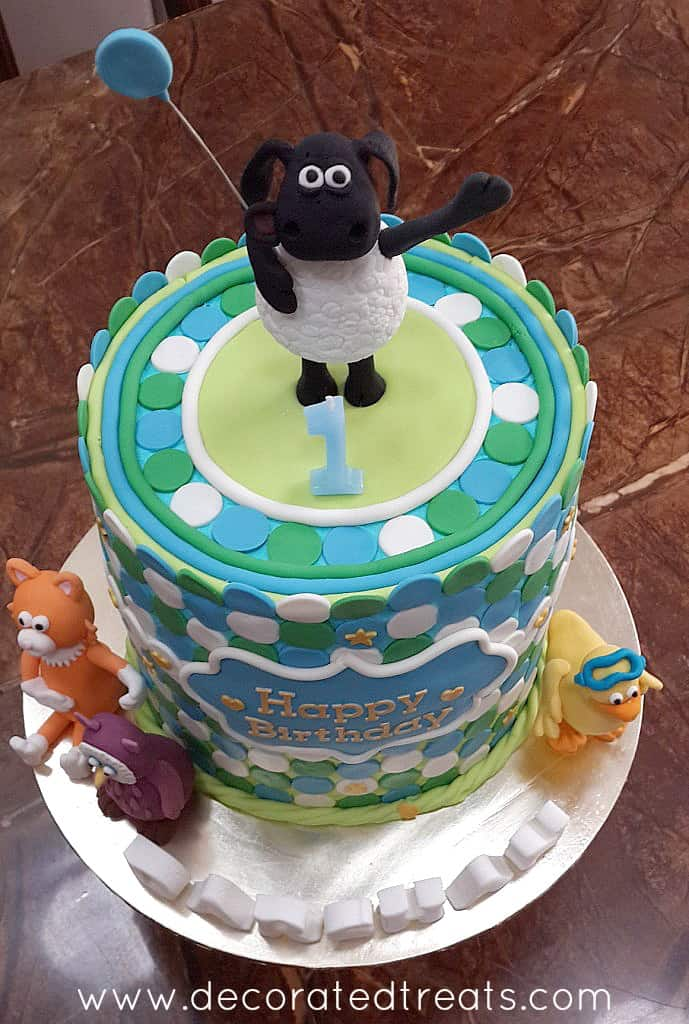 A Timmy Time cake with fondant decorations on buttercream