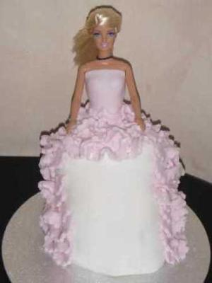 Doll cake with white and pink frilly dress design