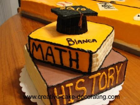 A stack of books cake with a graduation cap topper