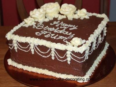 Square cake with brown and white icing.