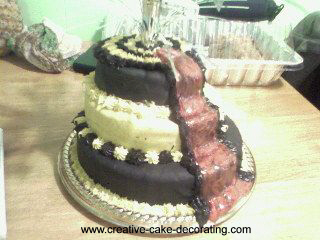 3 tier cake with black and white icing and red carpet decoration.