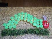 A green caterpillar cake made using cupcakes.