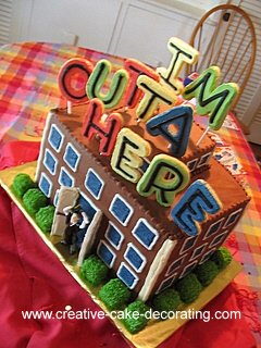 A tall rectangle cake as a building with wordings on top