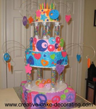 Fun cake design with colorful tier cake on pillars
