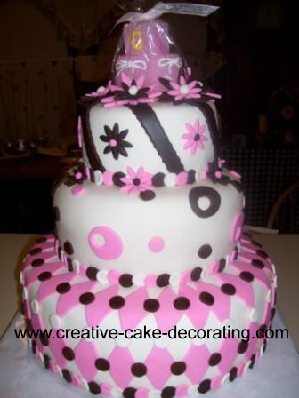 3 tier pink, white and black cake