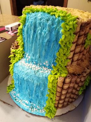 2 tier cake with waterfall design and Moana topper