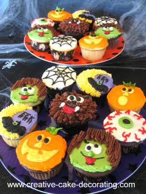 A range of monster themed cupcakes on 2 plates