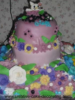 2 tier purple cake with floral design