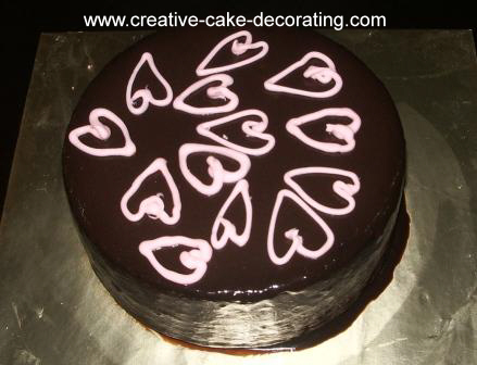 Brown cake with pink heart designs