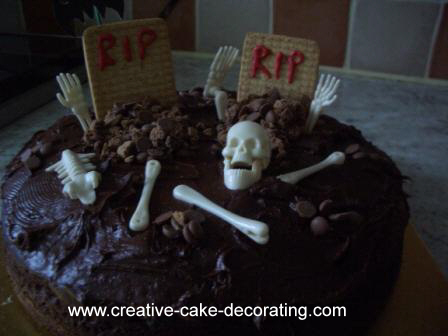 Chocolate cake with skulls and bones in white