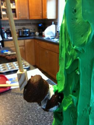 The side construction of a cactus shaped cake