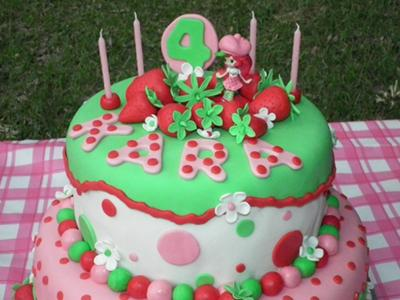 2 tier Strawberry Shortcake themed pink, green and white cake