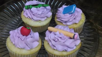 Cupcakes with purple swirl icing and teachers day themed fondant toppers