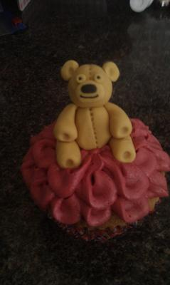 Cupcake with pink frills and 3d fondant teddy bear topper