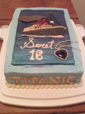 A rectangle cake in blue icing, with the Titanic ship image.