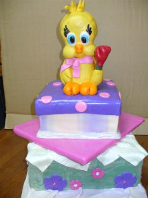 A square tiered cake with Tweety Bird topper
