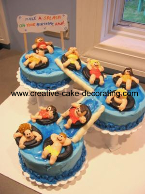 3 separate round cakes with edible slides connecting them for a water park themed cake.