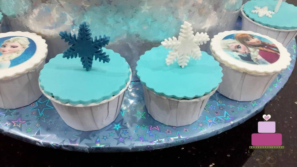 Cupcakes in blue with white and dark blue snowflake cupcake toppers