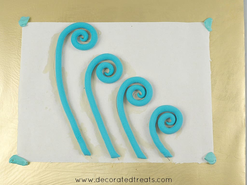 Fondant swirls in light blue