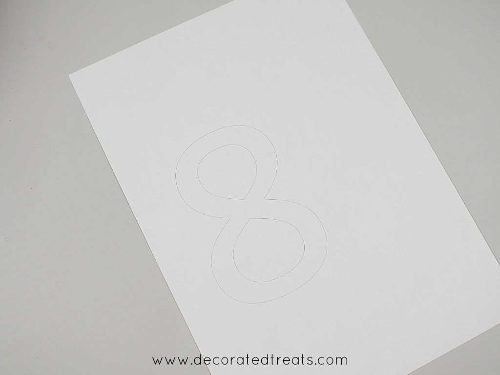 A white paper with number 8 printed on it