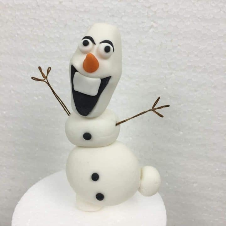 3D Olaf cake topper with its arms stretched out