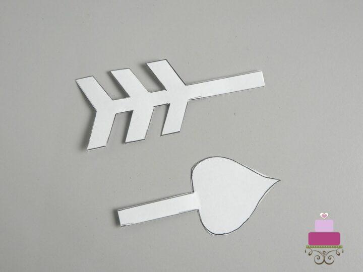 Arrow paper template cut into 2