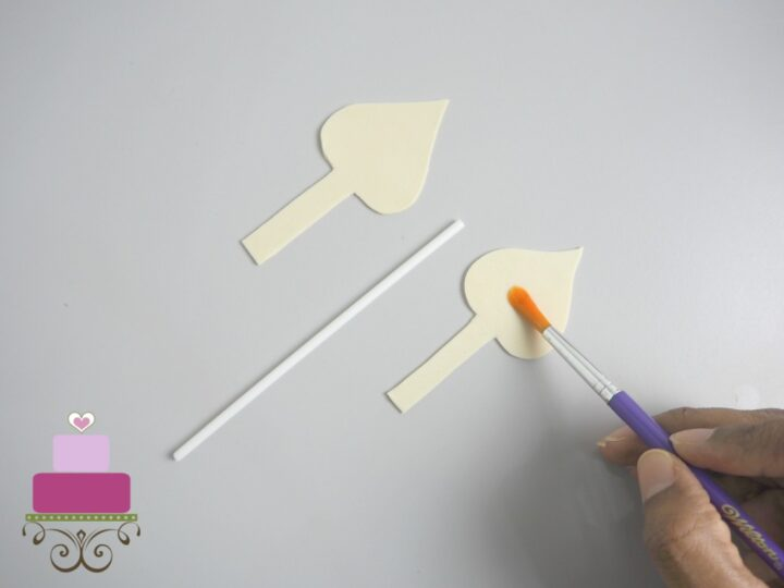 Applying fondant glue to gum paste
