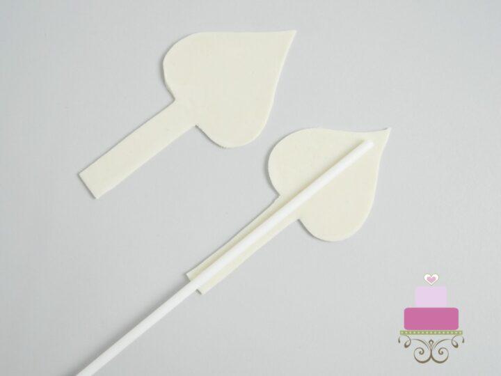 Attaching lollipop stick to gumpaste arrow