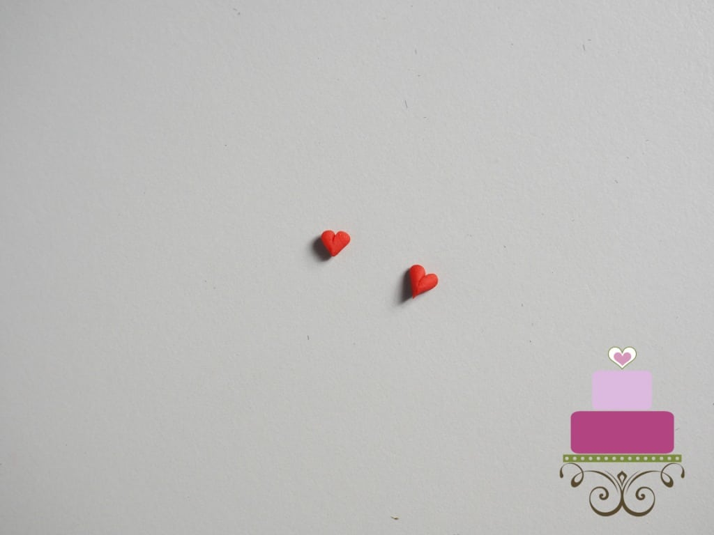 2 tiny red fondant hearts