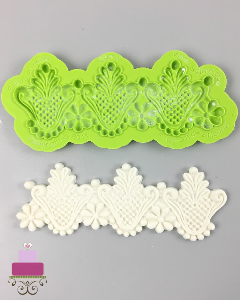 A green silicone mold with molded fondant below