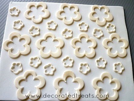 Floral shaped fondant cut-outs in beige